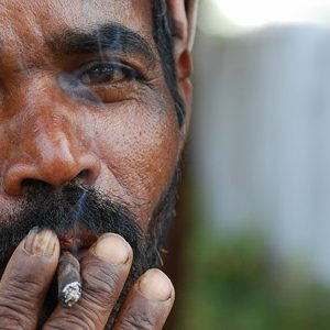 Older Indian man smoking